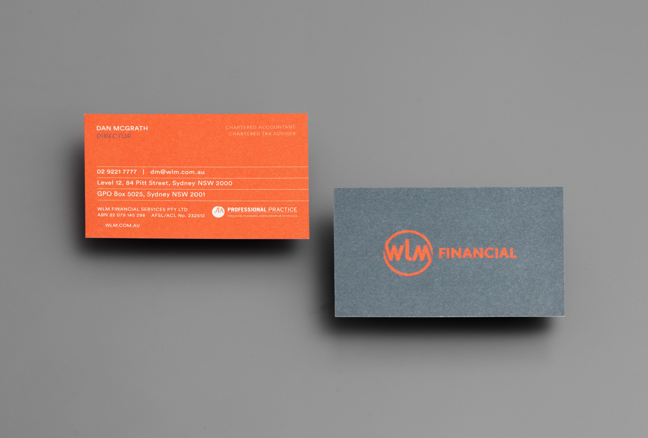 Back and front of business cards, WLM Financial.